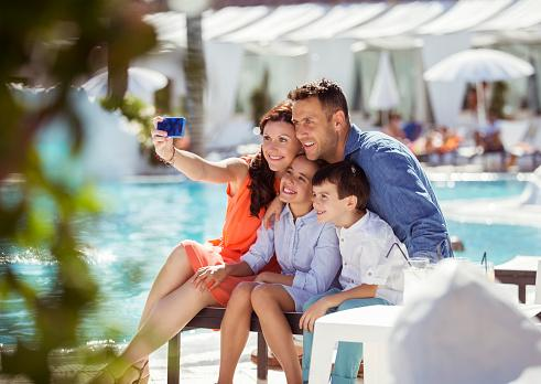 Family taking picture by the pool