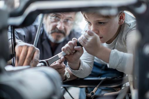 Child fixing a car